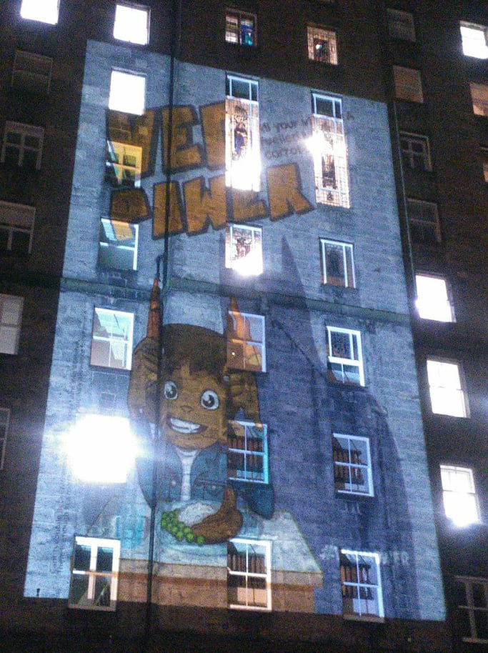 VegPower poster projected on a building